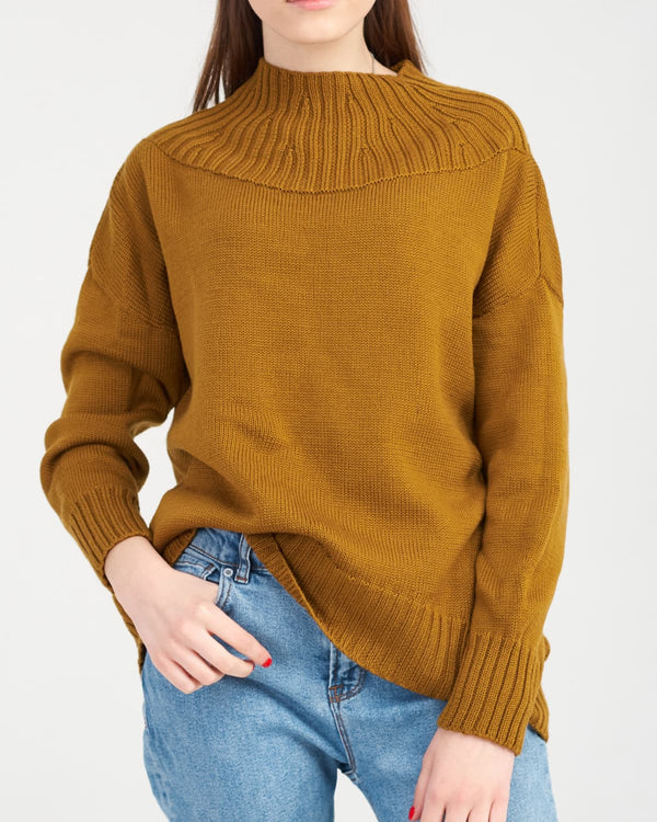 merino sweater in bright color on a girl in jeans