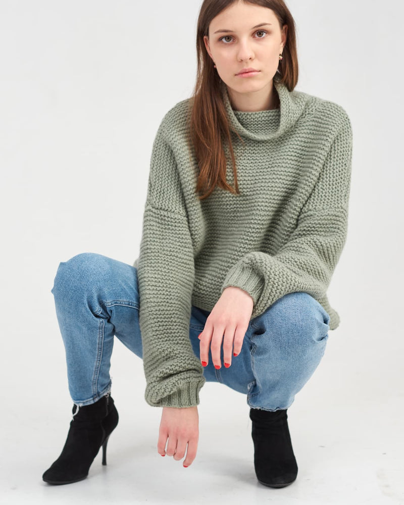 girl in casual style - oversized sweater and jeans
