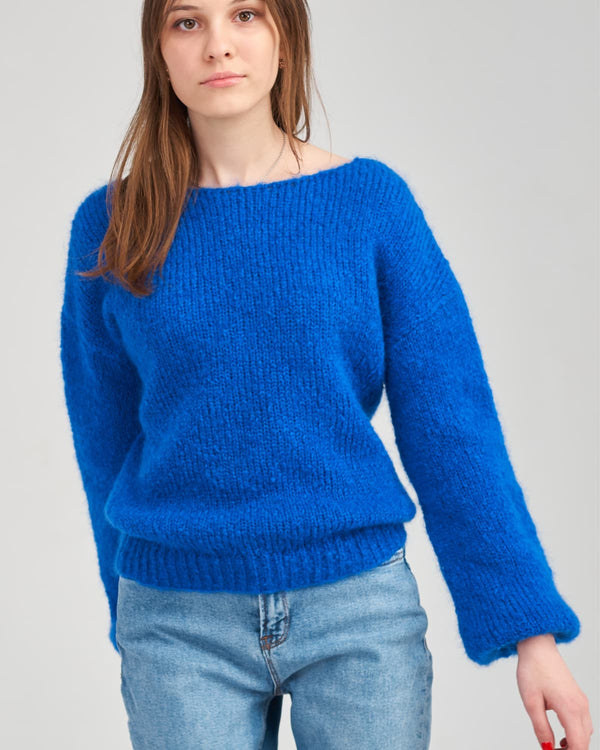 Young woman in blue mohair sweater