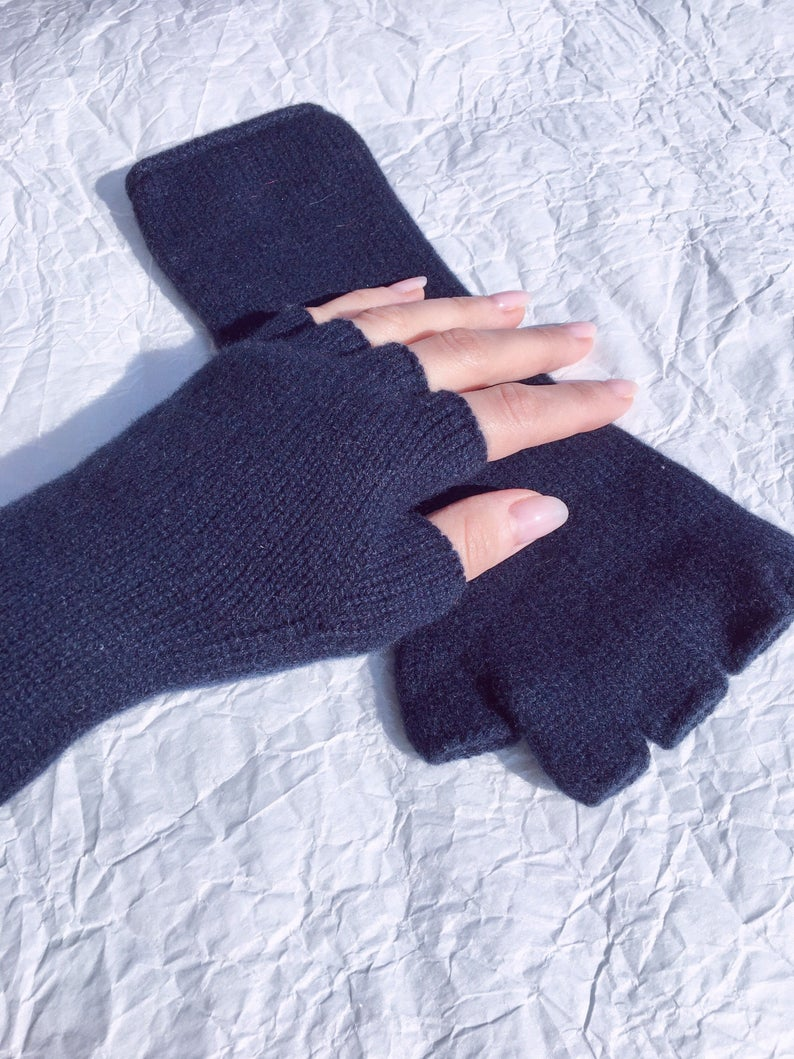 thin fingerless gloves on the woman's wrist