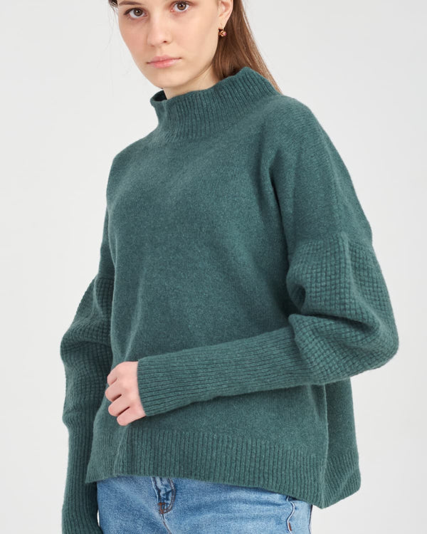 girl in a knitted sweater with puffy sleeves