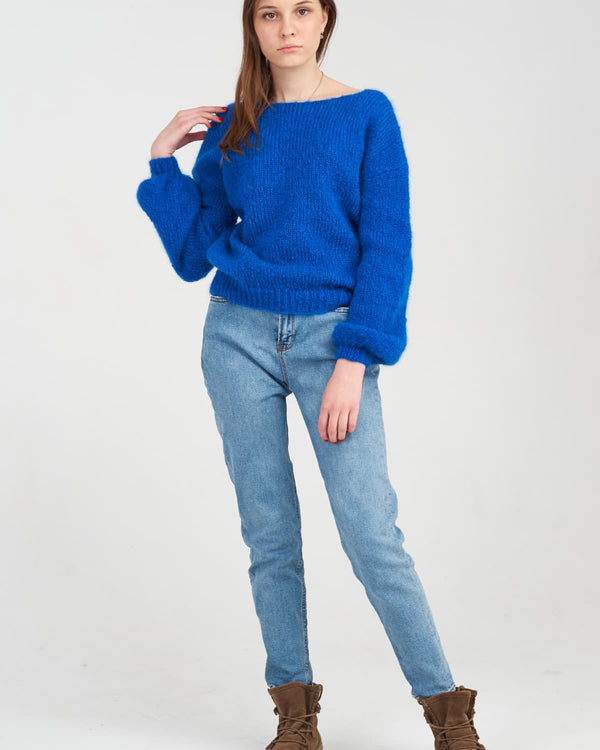 beautiful model of a blue sweater with an open back