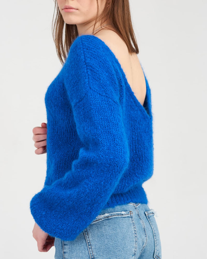 warm sweater with an intriguing plunging back