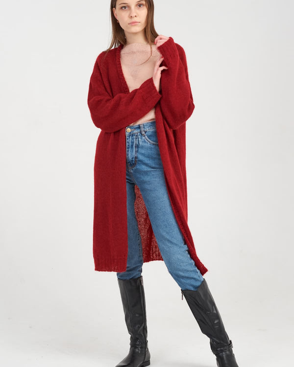 Woman in red knitted cardigan