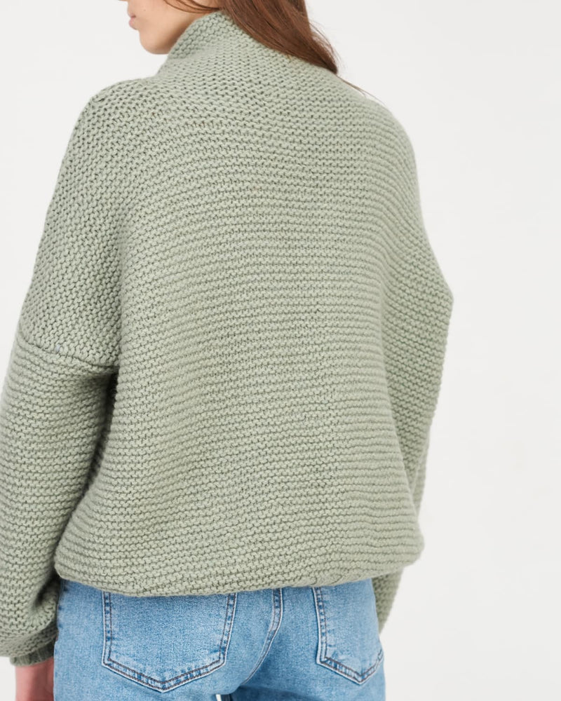 woolen sweater on a woman back view