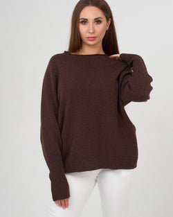 girl trying on stylish cashmere sweater