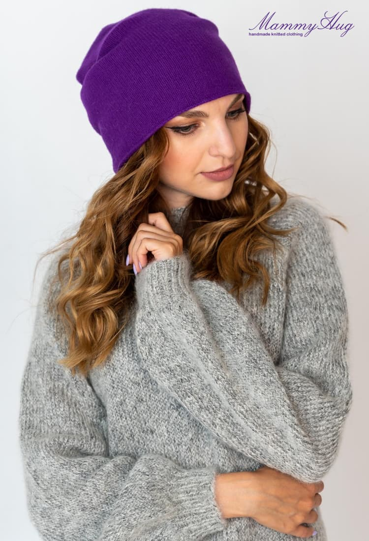 lady in knitted sweater and stylish beanie hat