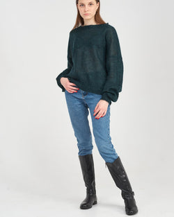 Girl in an emerald knitted pullover