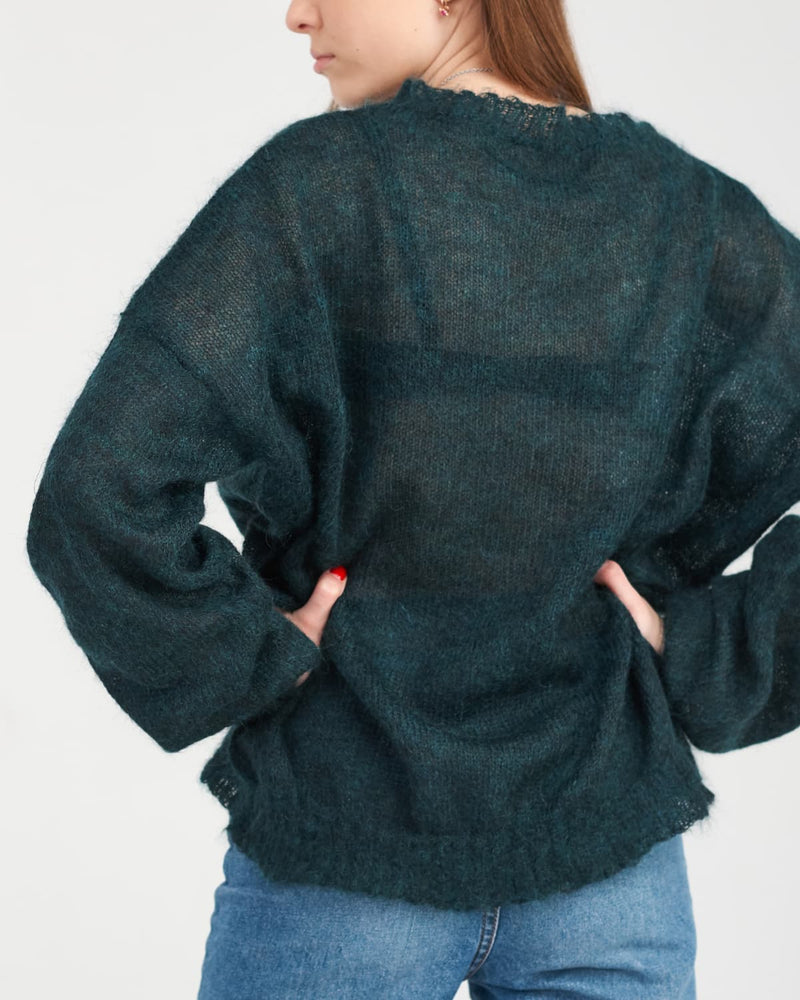 Lady in oversized mohair pullover from the back