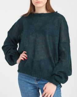 Woman in sheer knitted pullover with puff sleeves