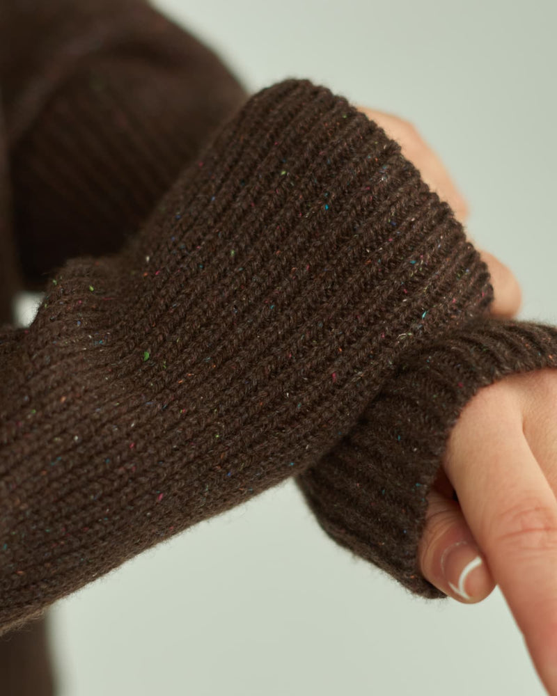 Brown cable knit sweater sleeve close up