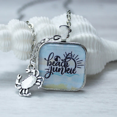 Beach Junkie square cabochon necklace on 24 inch chain with crab charm by Favored Whispers beach jewelry collection.