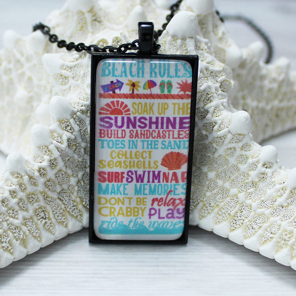 Beach Rules 1x2 rectangle cabochon necklace on 24 inch black chain by Favored Whispers. Beach Jewelry.