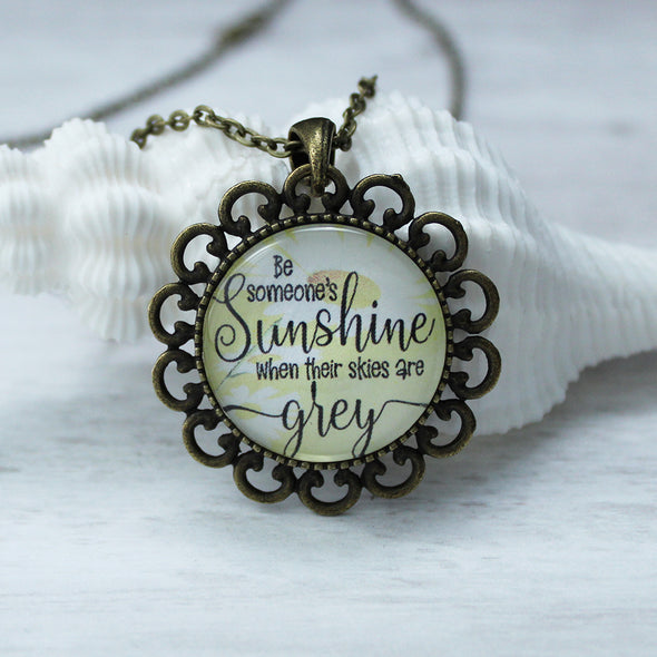 be someones sunshine necklace with a flower pendant and 16 inch bronze chain by favored whispers