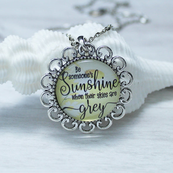 be someones sunshine necklace with a flower pendant and 16 inch silver chain by favored whispers