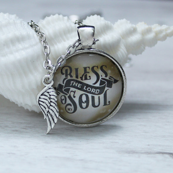 bless the lord o my soul on golden background with silver necklace and angel wing charm by favored whispers