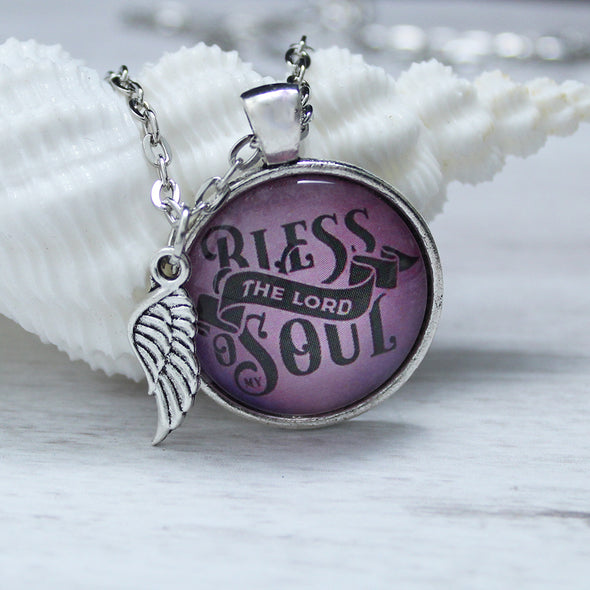 bless the lord o my soul on purple background with silver necklace and angel wing charm by favored whispers