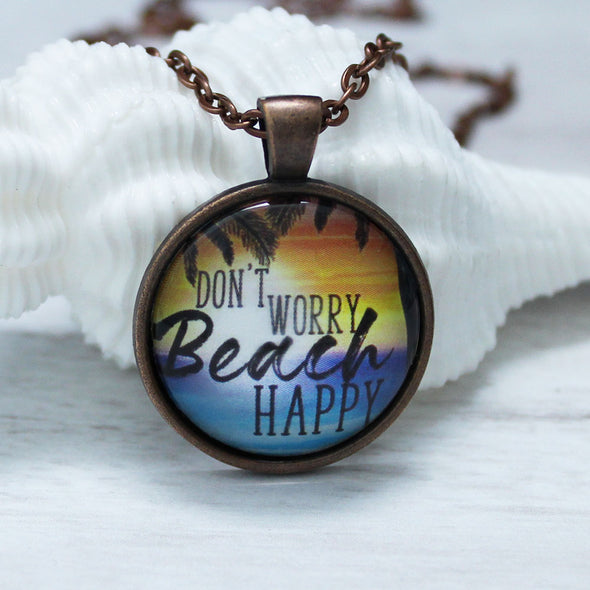 don't worry beach happy with ocean and sunset on copper chain by favored whispers, cabochon