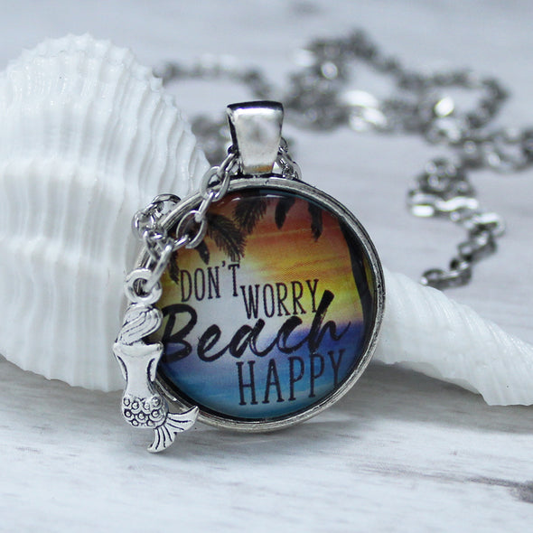 don't worry beach happy with ocean and sunset on silver chain with mermaid charm by favored whispers, cabochon