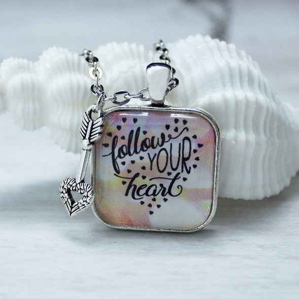 Follow your heart 1 inch square necklace on 24 inch silver chain with arrow heart charm by Favored Whispers inspirational jewelry collection.
