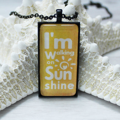 I'm Walking On Sunshine 1x2 rectangle cabochon necklace on 24 inch black chain by Favored Whispers.