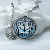 Let's Get Nauti round cabochon necklace on 24 inch silver chain with sailboat charm by Favored Whispers beach jewelry collection.