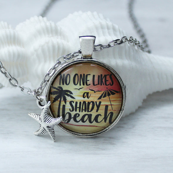 No one likes a shady beach on sunrise background cabochon necklace on 24 inch chain and starfish charm by Favored Whispers. Beach jewelry.