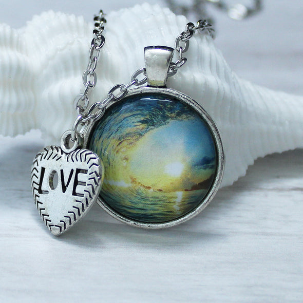 ocean wave and sunrise photo necklace with silver chain and love charm by favored whispers