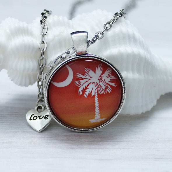 South Carolina State Flag cabochon necklace, palmetto tree with love charm, white on sunset background by Favored Whispers