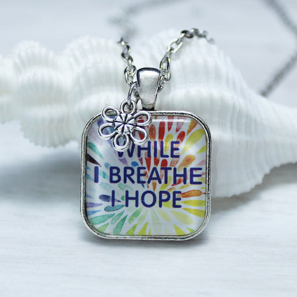 While I breathe I hope square cabochon necklace with flower charm on silver necklace by Favored Whispers. Inspirational jewelry.