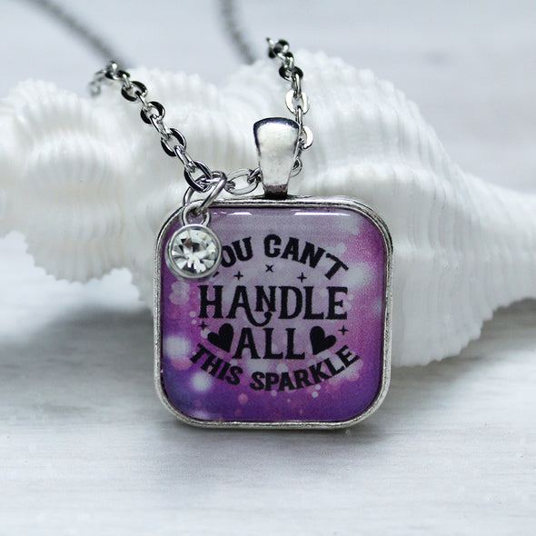 You Can't Handle All This Sparkle with purple background square cabochon necklace with crystal charm on 24 inch silver chain by Favored Whispers. Inspirational jewelry.