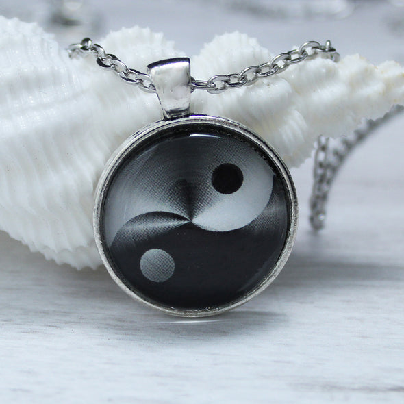 Black and white yin yang cabochon necklace on silver chain by Favored Whispers.