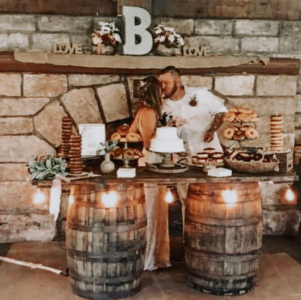 Whiskey barrels with table top