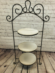 Three tier metal stand with plates