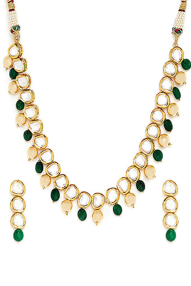 Alloy Kundan Neckpiece with Earrings in Gold and White