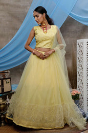 Buy Net Thread Work Lehenga Choli in Light Yellow