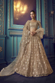 Buy Net Zari Work Lehenga Choli In Beige