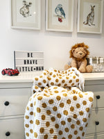 mustard yellow polka dot + muslin blanket + baby + momo and bubs + nursery