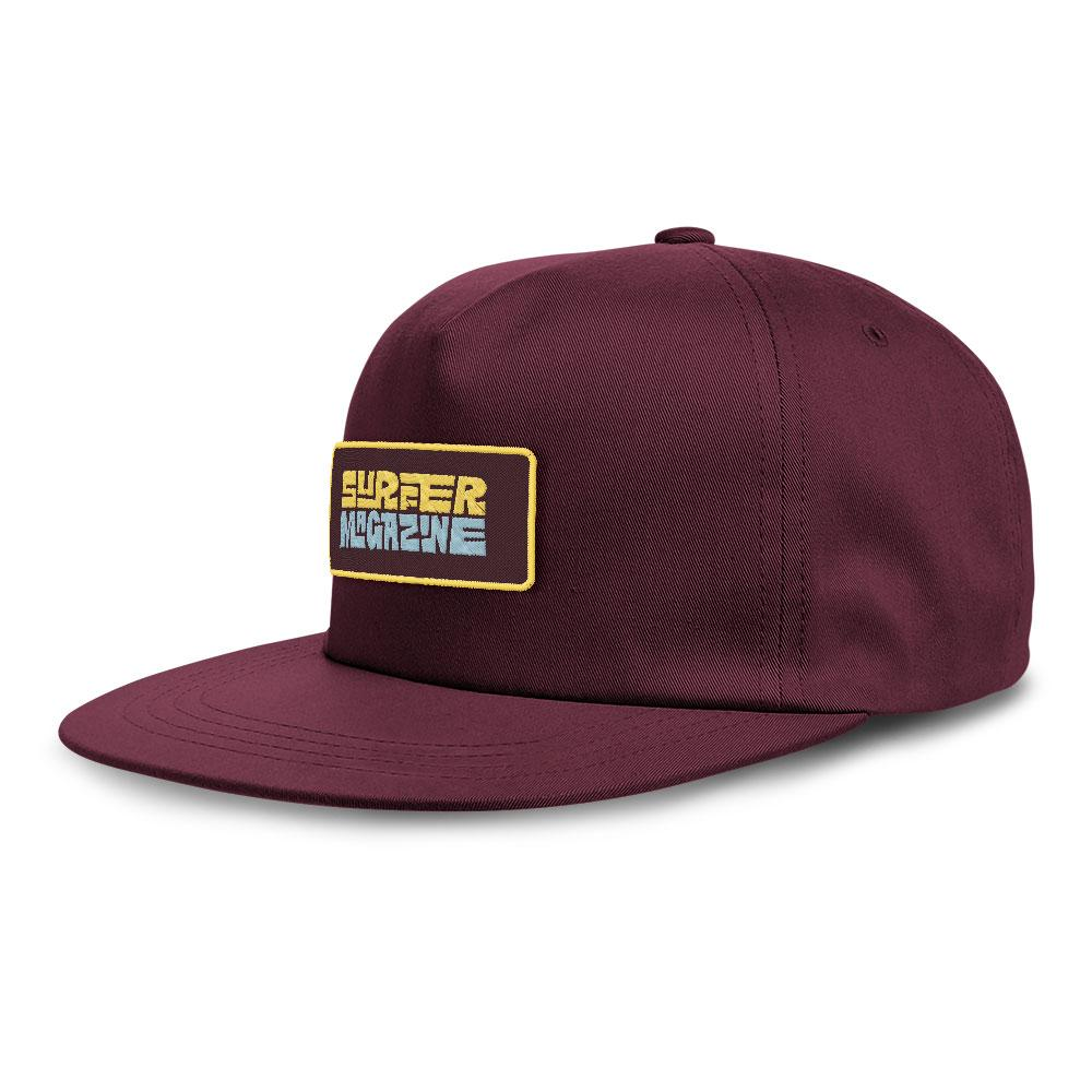 Maroon hat with surfer magazine embroidered patch, light blue and yellow letters