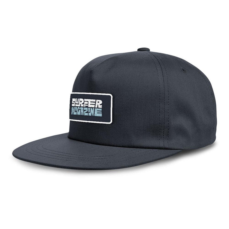 Navy hat with surfer magazine embroidered patch, light blue and white letters