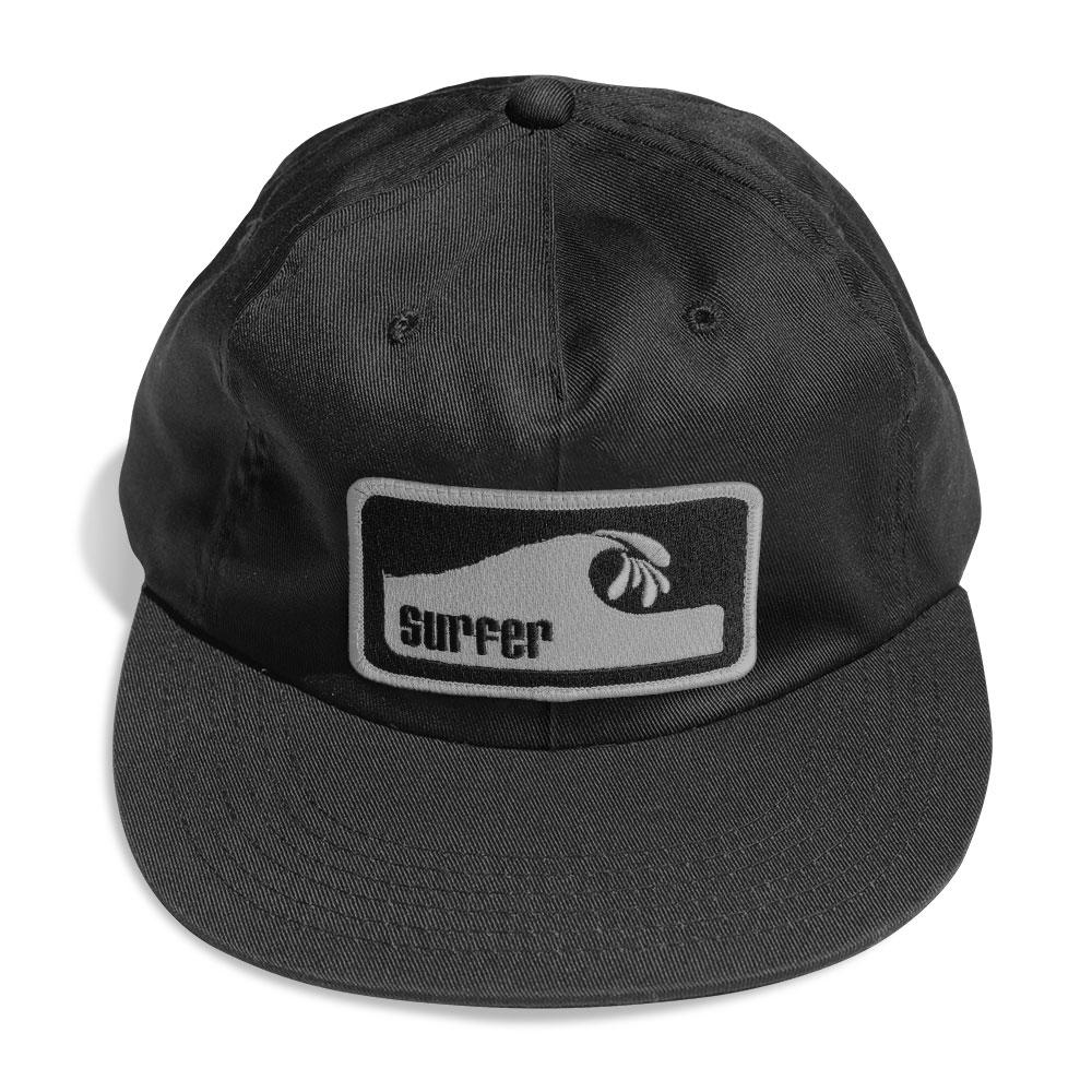 black six panel hat with silver and black embroidered surfer wave patch