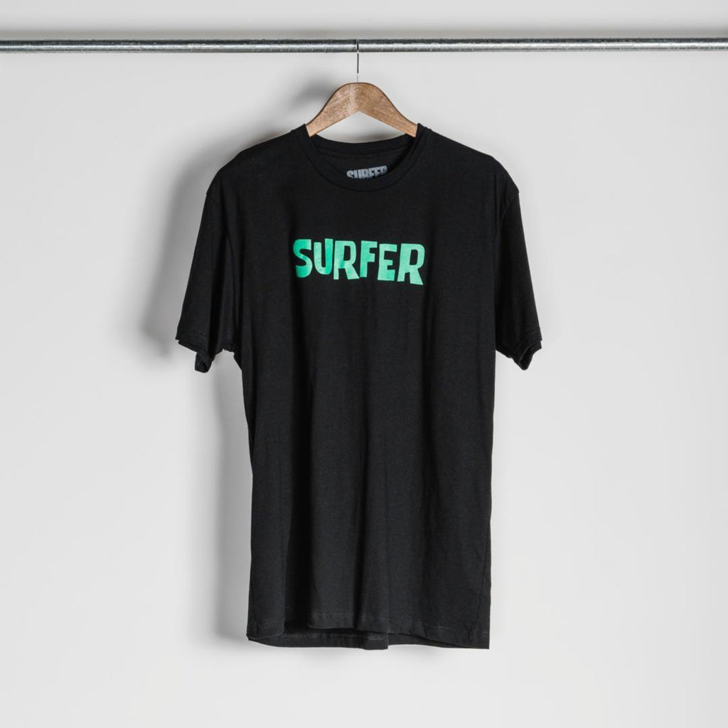 Black t-shirt with green OG Surfer logo across chest