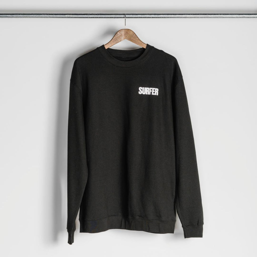 black crew neck sweatshirt with white surfer logo on left chest
