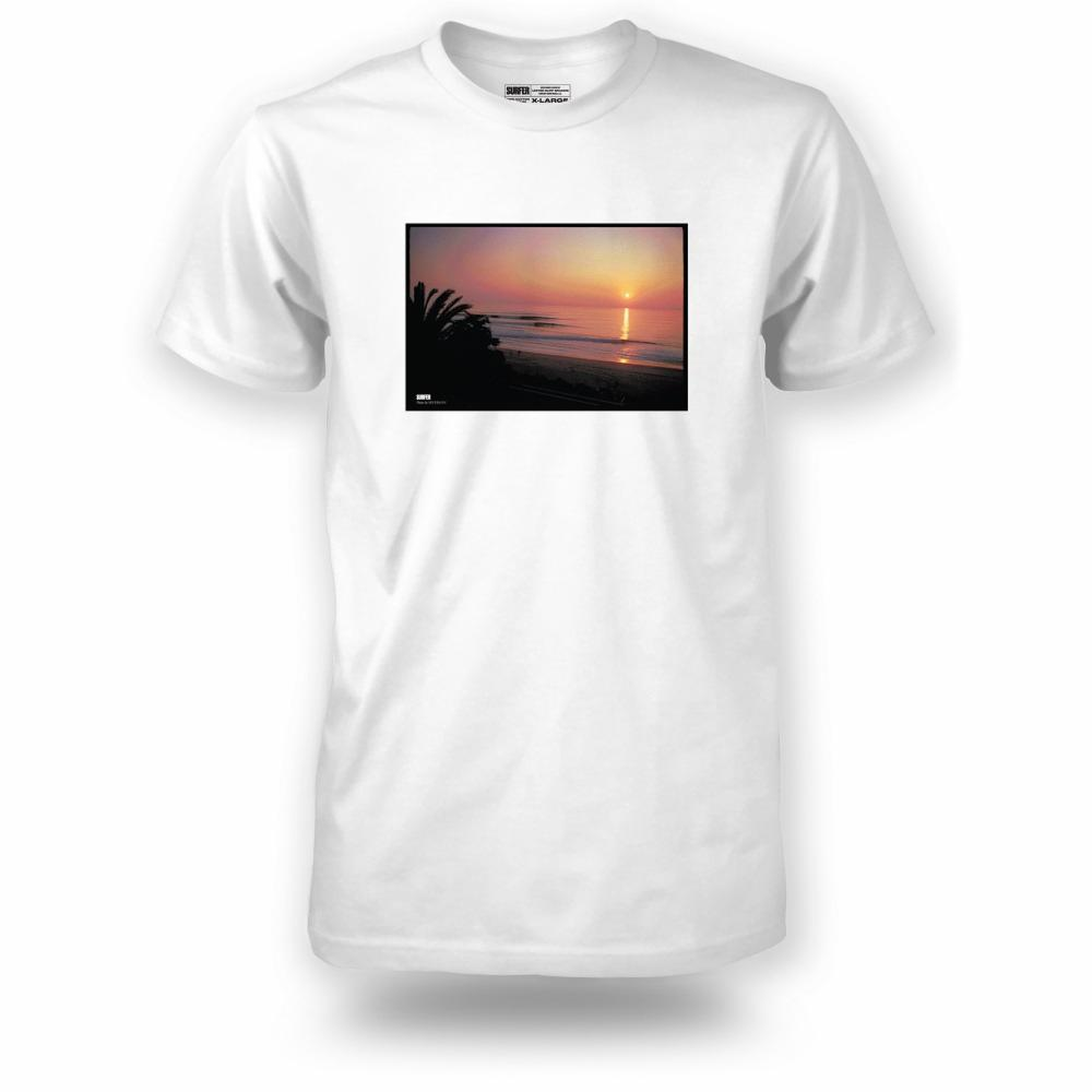 White t-shirt with Cotton's Point sunset photo printed on chest