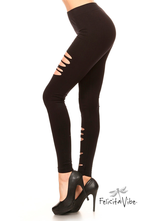 Profile view of High Waisted Black Shredded Distressed Yoga Leggings from Felicita Vibe