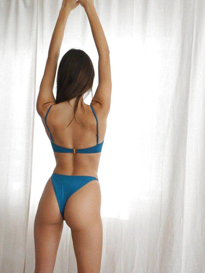 Model in blue bikini set