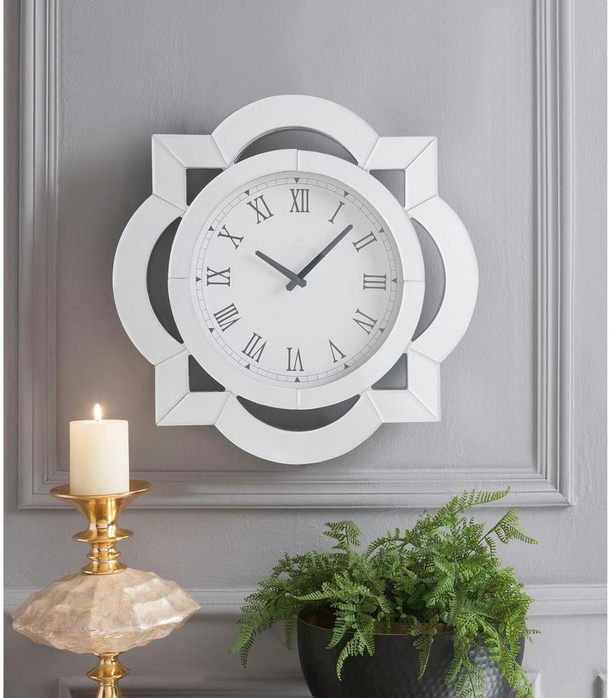 Claire Wall Clock above plant and candle