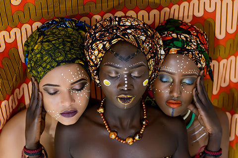 women wearing wooden african necklace