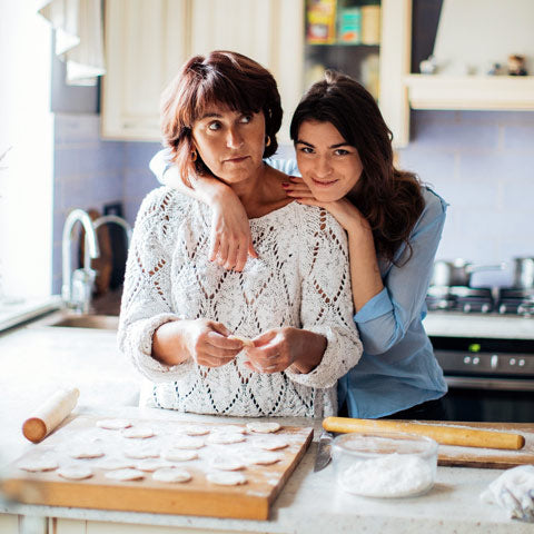 mum and daughter use wood rolling pins
