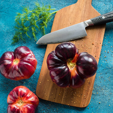 wooden chopping board with knife
